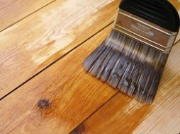 ... Does spraying improve the spread rate of water-based varnish?